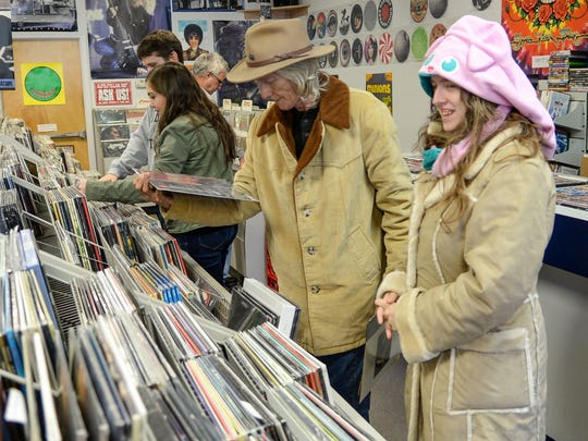 David LeRoy, left, and Melody LeRoy look at Black Friday Record Store Day vinyl records at Rainbow Records in Anderson on Friday.