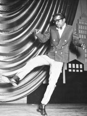 American entertainer Sammy Davis Jr. is seen dancing on stage at the Victoria Palace in London, during a rehearsal for a Royal Variety performance on May 19, 1960.
