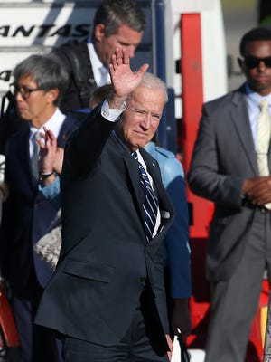 U.S. Vice President Joe Biden waves as he arrives in Sydney on Monday. Biden is visiting Australia as part of a tour of the Pacific.