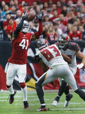 Arizona Cardinals defensive back Marcus Cooper (41) returns an interception for a touchdown against the Tampa Bay Buccaneers  in the second half  of their NFL game Sunday, Sept. 18, 2016 in Glendale.