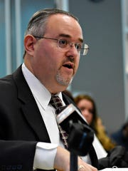 Helen Thackston Charter School's attorney Brian Leinhauser addresses the board as the York City School District holds a special meeting regarding the future of Helen Thackston Charter School at the Administration Building in York City, Feb. 13, 2017. Dawn J. Sagert photo