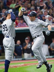 New York Yankees' Chase Headley celebrates after hitting a solo home run off Cleveland Indians relief pitcher Zach McAllister with New York Yankees' Aaron Judge during the eighth inning of a baseball game in Cleveland, on Saturday, Aug. 5, 2017.