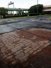 Midsouth Paving discovered historic brick, pictured here on Friday, Aug. 18, 2017, on North Hayne Street near the Pensacola Police Department. The paving is part of a $15 million street paving project throughout the city.