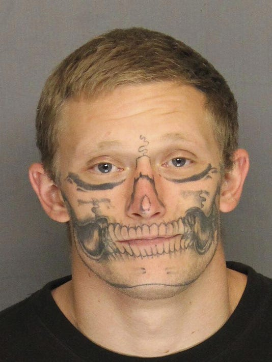Escapee Face Tattoo