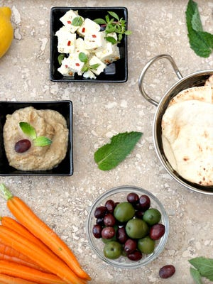 Smoky eggplant and chickpea dip with marinated feta cheese. [Photo by Lynda Balslev