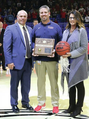 Marty DeJarnette (center), pictured after Columbia Academy's 2019 Class A state championship victory, was honored in Washington, D.C., this week as the National Christian Schools Association's Coach of the Year during the organization's annual conference.