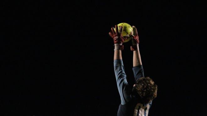 Leon goalie Cameron Walker snags a bouncing ball high in the air during a recent game against Chiles.