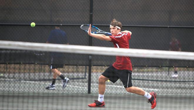 Asheville High senior Sam Brazil has signed to play college tennis for Charlotte.