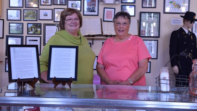 Town Manager Faye Lingo and volunteer Barbara Hall pose inside the Millsboro Museum.