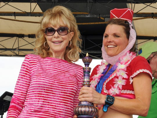 Barbara Eden, seen here with Lea Anne Richard, of Melbourne, one of the top female runners of the Ron Jon Cocoa Beach Half Marathon.