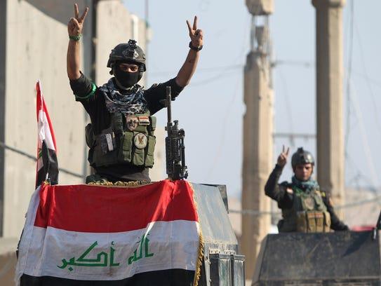 Members of Iraq's elite counter-terrorism service flash