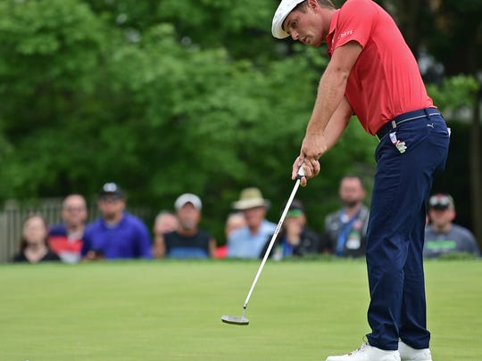 Bryson DeChambeau follows his putt on the seventh hole during the final round of the Memorial golf tournament Sunday, June 3, 2018, in Dublin, Ohio. (AP Photo/David Dermer)