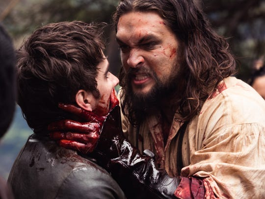 Irish stowaway Michael Smyth (Landon Liboiron) has a bloody first encounter with merciless fur trader Declan Harp (Jason Momoa), whom he has been tasked to track down in Netflix drama 'Frontier.'