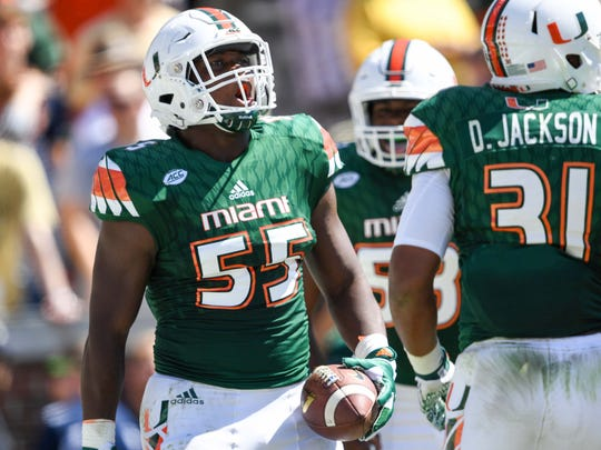 Miami linebacker Shaquille Quarterman (55) and defensive