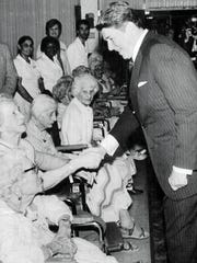 President Ronald Reagan greets residents of the Wellington