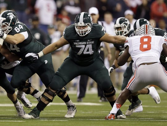 Michigan State's Jack Conklin (74) blocks against Ohio