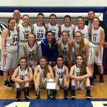 Crane High School's girls basketball team celebrates winning the Class 2 District 11 championship in Marionville on Friday night.