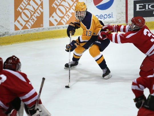 Port Huron Northern junior Corey Easton looks to take a shot on goal during the Larry Manz Holiday Hockey Tournament Saturday, November 28, 2015 at McMorran Arena. Northern beat Anchor Bay 6-5 in overtime.