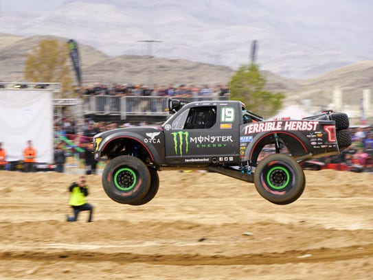 The Terrible Herbst truck flies over a jump near the