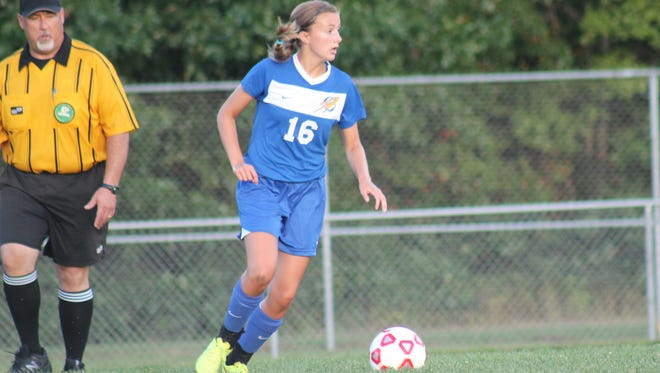 CNE's Andrea Johnson dribbles the ball upfield during the Lady Rockets' 2-0 win over Bethel-Tate Sept. 2.
