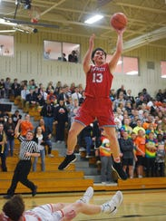 Lincoln's Jared Jaros takes a shot during the game