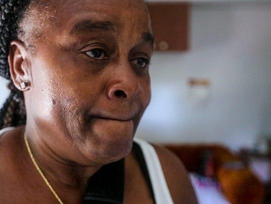 Luetricia Freeman Becker fights back tears as she talks