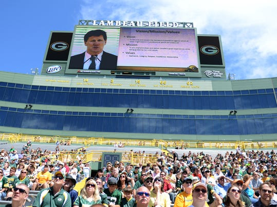 FILE - In this July 24, 2013 file photo, Green Bay Packers fans and stockholders attend the Packers NFL football team annual shareholders meeting at Lambeau Field in Green Bay, Wis. The screen at top shows team president Mark Murphy. The Packers offer their annual glimpse into the financial health of the only publicly owned team in the NFL, Thursday, July 10, 2014. (AP Photo/The Green Bay Press-Gazette, H. Marc Larson, File) NO SALES