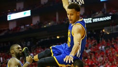 Stephen Curry #30 of the Golden State Warriors falls
