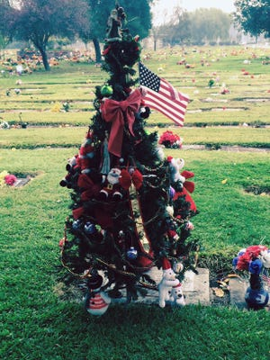 Christmas tree constructed by an anonymous mourner at the San Joaquin Catholic Cemetery in Stockton, CA.