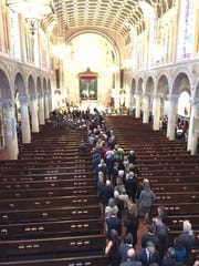 Mourners pay their respects inside St. Anthony of Padua church Friday during Beau Biden's viewing.