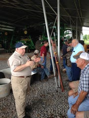 Louisiana Commissioner of Agriculture Mike Strain talks with farmers and ranchers affected by Red River flooding Friday.