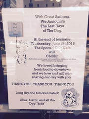 Sign announcing the closing of the Spotted Dog Cafe, located at 221 S. Washington Square. The cafe closed today, June 24, 2015.