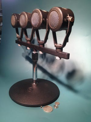 """These props, a set of replica Soviet microphones, a hollow nickel and a half-dollar coin with a hidden suicide capsule, were made by an Iowa inventor and used in the new Tom Hanks thriller """"Bridge of Spies."""""""