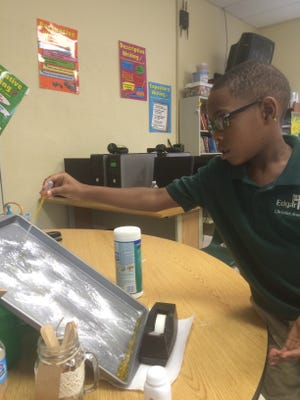 T.J. Edwards, 7, of Bridgeton experiments with gravity.
