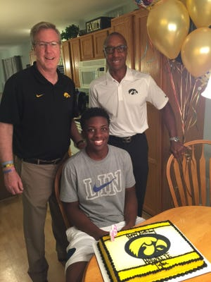 Tyler Cook was all smiles when signing with Fran McCaffery and the Hawkeyes last fall. Now he's helping his future coach on the recruiting trail..