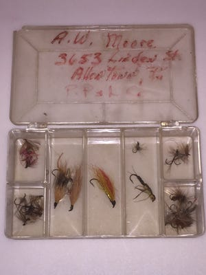 Andrew Moore's grandfather's fly box has is name and address on it and is filled with flies tied by his grandfather.