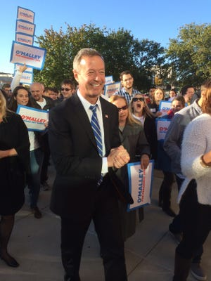 Martin O'Malley walks into the Iowa Events Center flanked by supporters ahead of the Iowa Democratic Party's Jefferson Jackson Dinner.