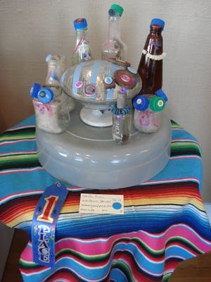"""""""The Picnic,"""" by Aerona Stewart, won first place in the youth category during the fifth annual Recycled Art Show hosted by the Deming Arts Council. The show was co-sponsored by Keep Luna County Beautiful."""