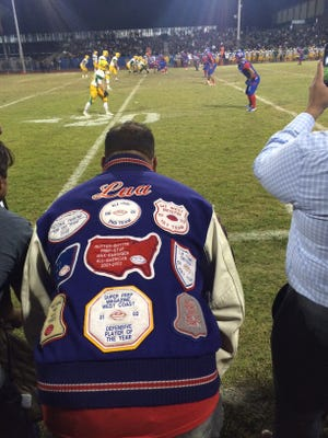 Indio grad and college and pro football player Oscar Lua returns to the sideline to root on the Rajahs.