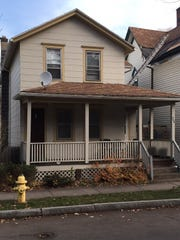 """Assemblyman obtained this house at 246 Lyndhurst St. in Rochester through """"adverse possession,"""" and got $36,381 from the city to spruce it up."""