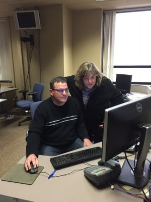 Executive Editor Stephanie Angel and Planning Editor Barry Kiel in the newsroom at 120 E. Lenawee Street on Friday, Jan. 15, 2016. Sunday, This weekend is the last that LSJ staffers will work in the old building. On Tuesday, after the Martin Luther King Jr. holiday, staff reports to new offices in the renovated Knapp's Centre on Washington Square.