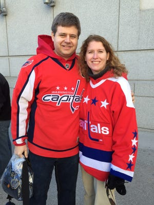 Washington Capitals fans Evan and Theresa Thomas, natives of Arlington, Va., are making all the stops in Nashville recommended by former Predators coach Barry Trotz.