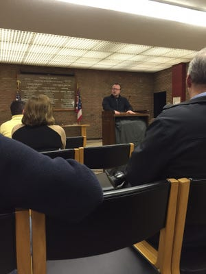 Don Reninger, president of RSSUM Holdings LLC, the company behind a Tim Horton's/Donatos Pizza restaurant planned for Bucyrus, speaks to city residents Tuesday in City Council chambers.