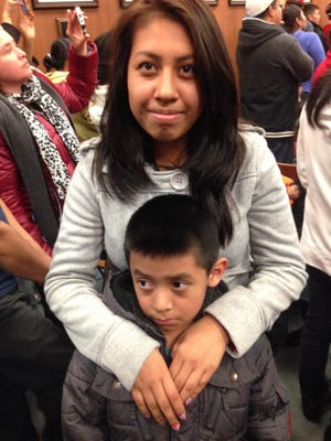 Elizabeth Ramos, 18, says she's worried about her brother, Isaac Campos, 7, walking a mile to school.