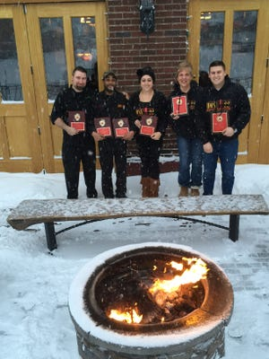 The Hose 22 crew warming up with their awards around the fire pit in front of the restaurant!