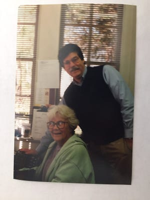 Harper Lee sits while Thomas Upchurch visits with her at Capitol Book & News in 1997.