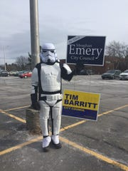 Ted Riehle, a South Burlington resident, stands in the parking lot of Frederick Tuttle Middle School dressed as a Storm Trooper to show his support for two City Council candidates Tuesday. Riehle said his wife serves on the council, and he had been out at the polling site since 7 a.m. when voting began.