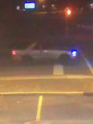 Lawrence police released this surveillance photo of a tan two-door Chevrolet  Blazer that struck a woman in a hit-and-run crash Wednesday