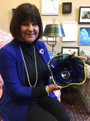 Karen Pence shows the centerpiece bowl that will decorate tables at her annual First Lady's Charitable Luncheon on Tuesday.