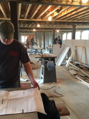 Workers ready the events space at The Pickwick Place for a June opening, in Bucyrus.